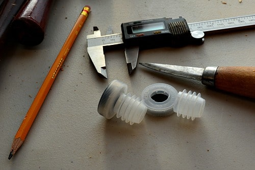 Bottle Stopper: Cutting the top off of the plastic insert.
