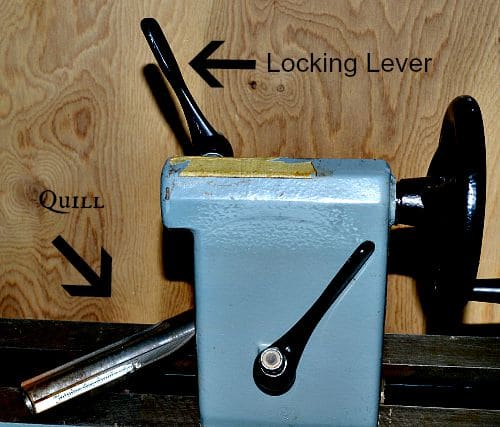 quill out of tail stock resting on the rails of the wood lathe