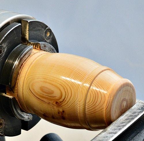 Woodturning bottom of barrel being finished