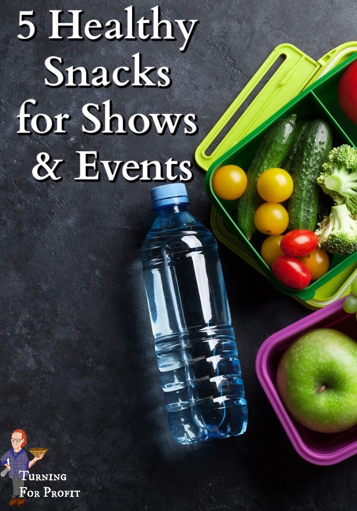 A water bottle and fresh fruit and vegetables