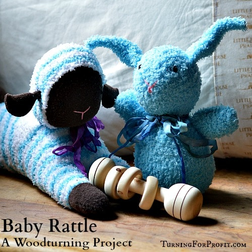 A turned Baby Rattle with three captive rings.