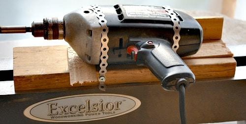 tea light holder, hand drill attached to the wooden sled with strapping