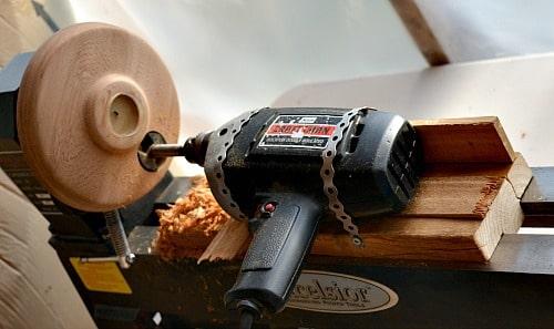tea light holder, turn on the hand drill and slide the sled forward towards the head stock