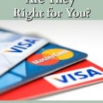 Visa and Mastercard credit cards fanned out on a white background