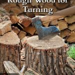 Chopped wood and axe in chopping block