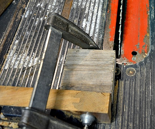 Use a clamp to hold small pieces of wood.