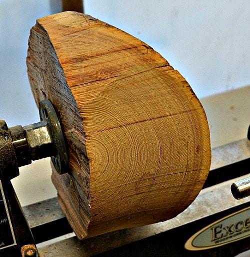 Bowl blank on lathe, no shape to the yarn bowl yet