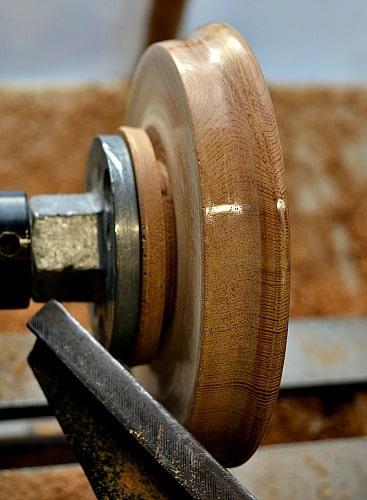parting the cedar trivet off of the lathe